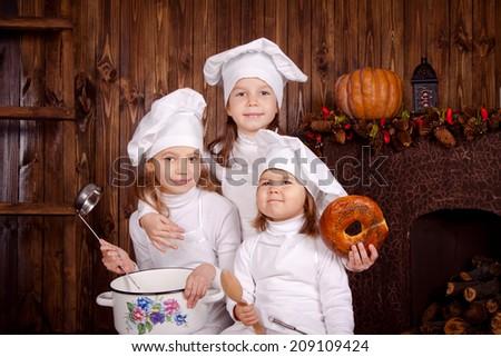 Joyful little chef, cook children - stock photo