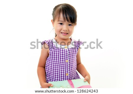 Joyful little girl holding present in hands