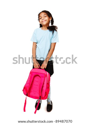Joyful little girl with a backpack