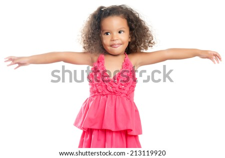 Joyful little girl with an afro hairstyle laughing with her arms extended isolated on white