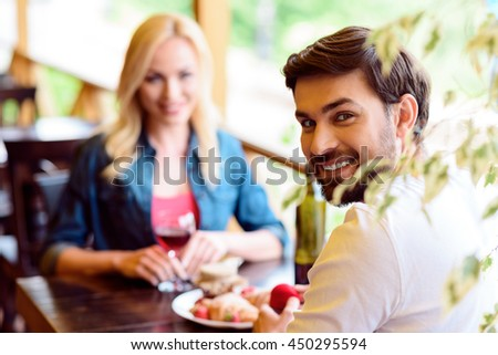 Joyful lovers engaging in cafe - stock photo