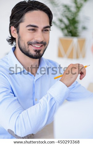 Joyful man deals with business partner - stock photo
