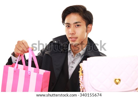 Joyful man holding gifts in his hands - stock photo