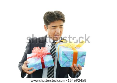Joyful man holding presents in hands