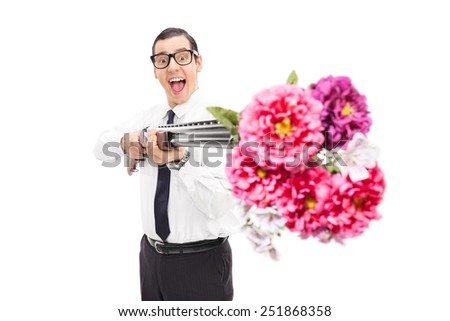Joyful man shooting flowers from a shotgun isolated on white background - stock photo