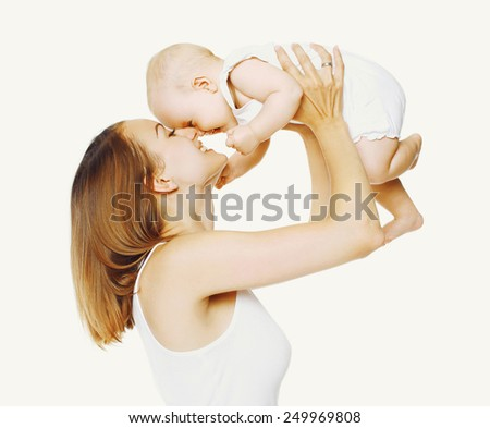Joyful mother and baby having fun together - stock photo