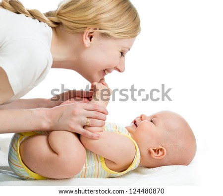 joyful mother playing with her baby infant - stock photo