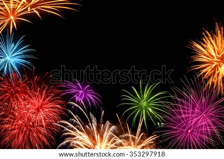Joyful multi-colored fireworks as a frame with black copyspace in the background, ideal for New Year or other celebration events - stock photo