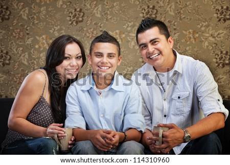Joyful Native American family sitting together indoors - stock photo