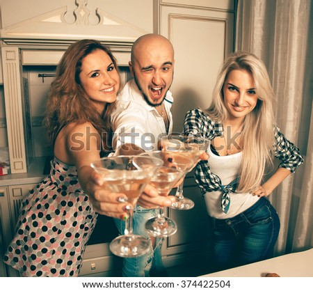 joyful people at a party with a martini. Celebrate, disco, party, nightlife, entertainment, friendship concept. - stock photo
