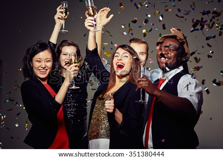 Joyful people toasting with champagne at party - stock photo