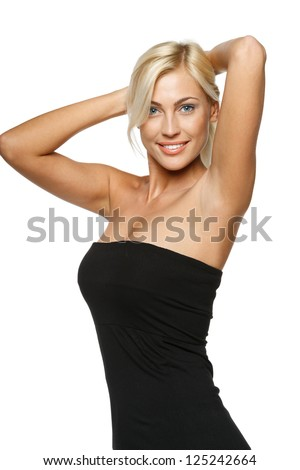 Joyful relaxed woman standing with hands over head, over white background - stock photo