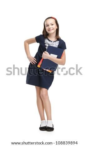 Joyful schoolgirl carries her books, isolated, white background - stock photo