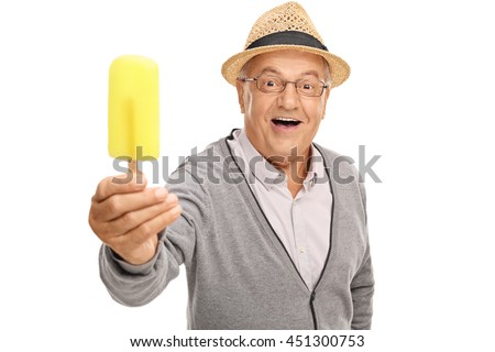 Joyful senior man holding a yellow popsicle isolated on white background