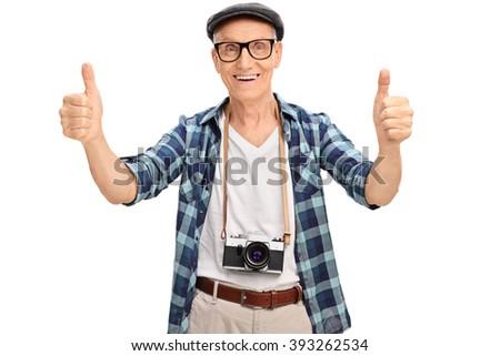 Joyful senior tourist giving two thumbs up isolated on white background - stock photo