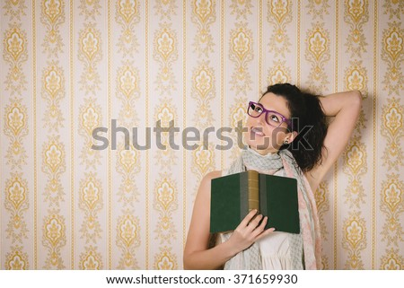 Joyful smart woman reading book and using imagination. Female daydreamer relaxing with lecture. - stock photo