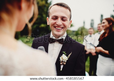 Joyful smile of the groom on the wedding ceremony