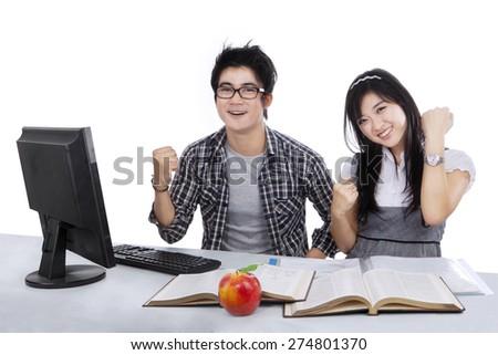 Joyful students expressing success, isolated on white background - stock photo