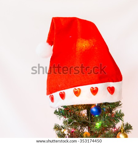 Joyful studio shot of a Christmas tree with colorful ornaments and lighting, on white background - stock photo
