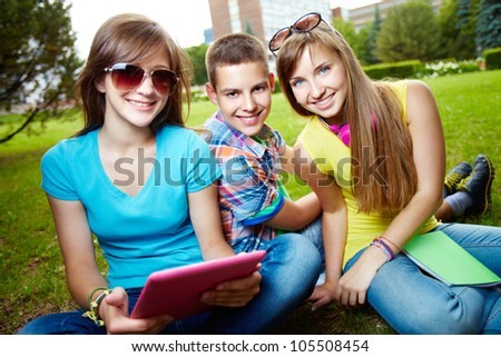 Joyful teens spending summer in the city and enjoying each other�s company