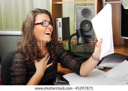 Joyful woman happy with her work - stock photo