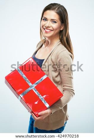 Joyful woman hold red gift box. Isolated portrait. - stock photo