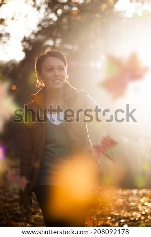 joyful woman walking in forest  - stock photo