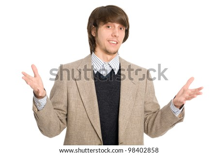 Joyful young businessman welcoming with open hands - stock photo