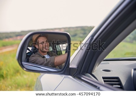 Joyful young man driving transport
