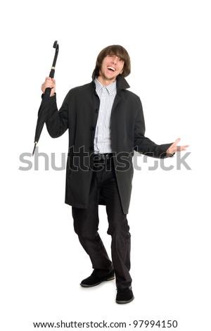 Joyful young man in a raincoat. - stock photo