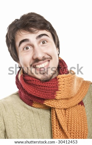 joyful young man wearing a scarf and green pullover - stock photo