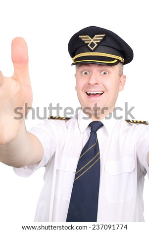 joyful  young pilot with outstretched hands - stock photo