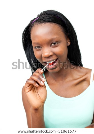 Joyful young woman eating a pizza against a white background
