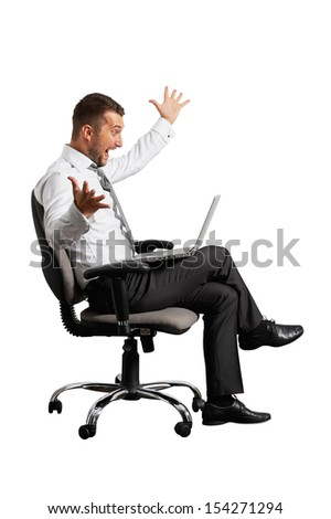 joyous businessman looking at laptop. isolated on white background - stock photo