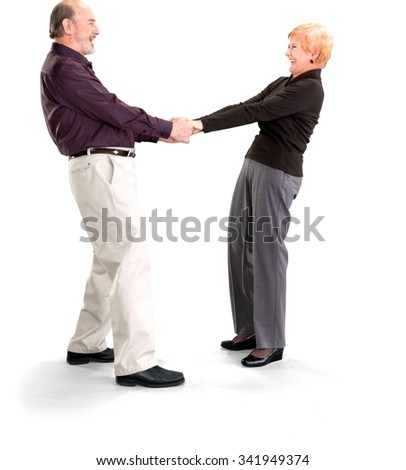 Joyous Elderly Caucasian couple dancing - Isolated - stock photo