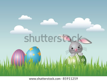 JPEG illustration of an Easter landscape with three colorful Easter eggs. A smiling Easter bunny is holding one of the eggs. Also available as vector file.