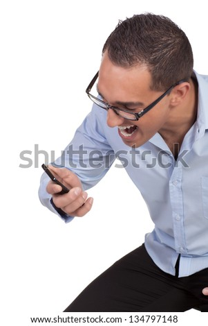 Jubilant man wearing glasses reading a mobile message laughing in glee as he receives good news isolated on white - stock photo