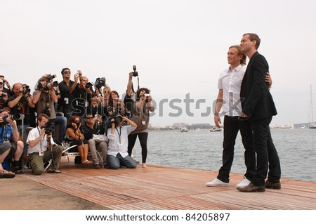 "Jude Law & director Jeremy Gilley (left) at photocall to promote their new movie ""The Day After Peace"" at the 61st Annual Cannes Film Festival. 5-19-08  Cannes, France. By: Paul Smith / Featureflash - stock photo"