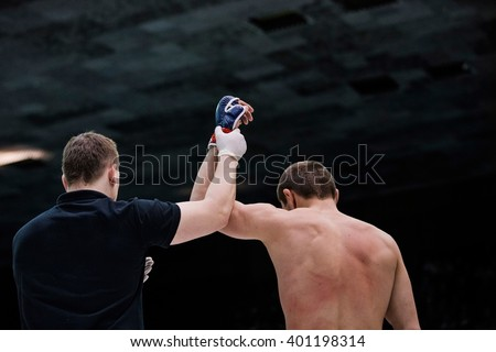 judge announces winner of fighter of fight in ring in Boxing - stock photo
