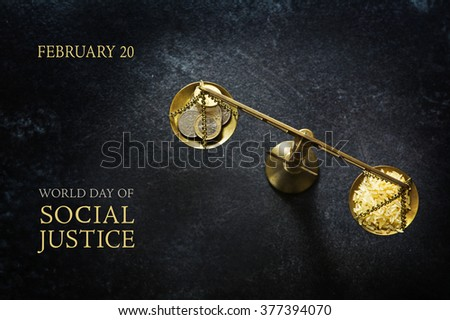 Judge balance with rice and coins on a dark slate plate, view from above, concept with text World Day of Social Justice, February 20, selected focus, narrow depth of field - stock photo