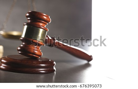 Judge concept. Gavel, golden scales of justice. Gray stone background. Law symbols. Place for typography.