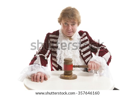 judge declares the legal proceeding with a final hit using the gavel - stock photo