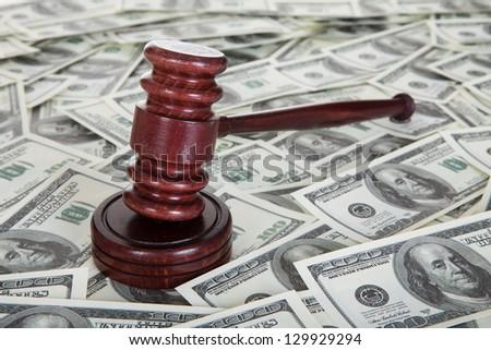 Judge gavel and dollar bills. Corruption concept - stock photo