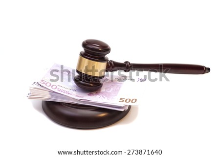 Judge gavel and euro banknotes isolated on white - stock photo