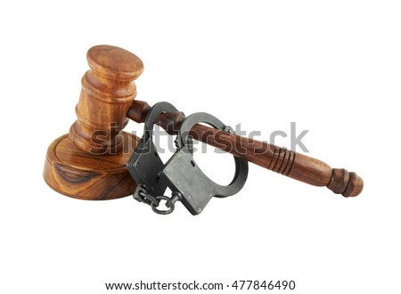 Judge gavel and handcuffs isolated on white background