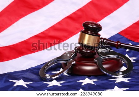 Judge Gavel and Handcuffs over American Flag - stock photo