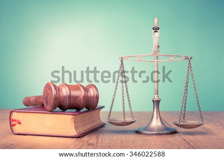 Judge gavel and low scales and book. Symbol of justice. Retro old style filtered photo