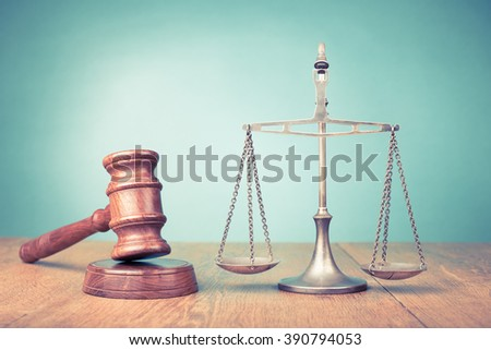 Judge gavel and low scales on table. Symbol of justice. Retro old style filtered photo