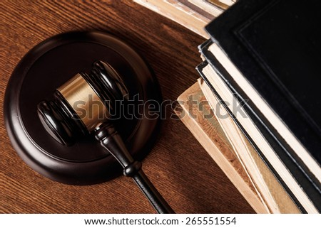 Judge gavel and old books  - stock photo