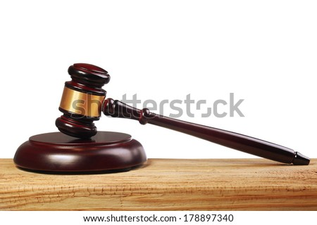 Judge gavel and soundboard on wooden table isolated on white background - stock photo